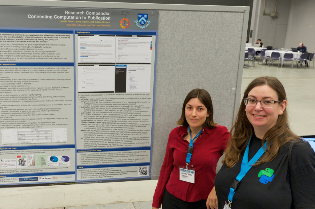 two people standing in front of a poster at PyCon 2014